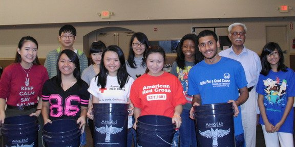 Alliance volunteers in Houston filling AICB buckets for flood affected families in Sinhd Pakistan    (17)