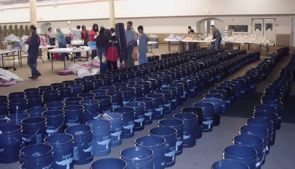 Alliance volunteers in Houston filling AICB buckets for flood affected families in Sinhd Pakistan    (20)